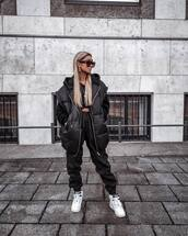 jacket,black vest,black pants,joggers,white sneakers,cropped hoodie,black sunglasses