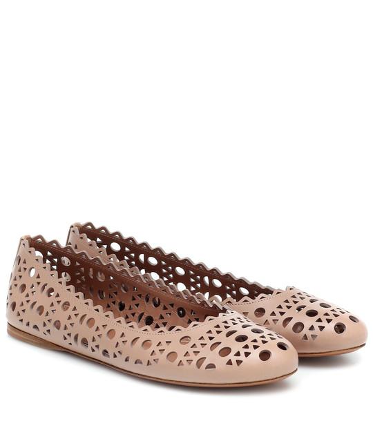 Alaïa Laser-cut leather ballet flats in pink