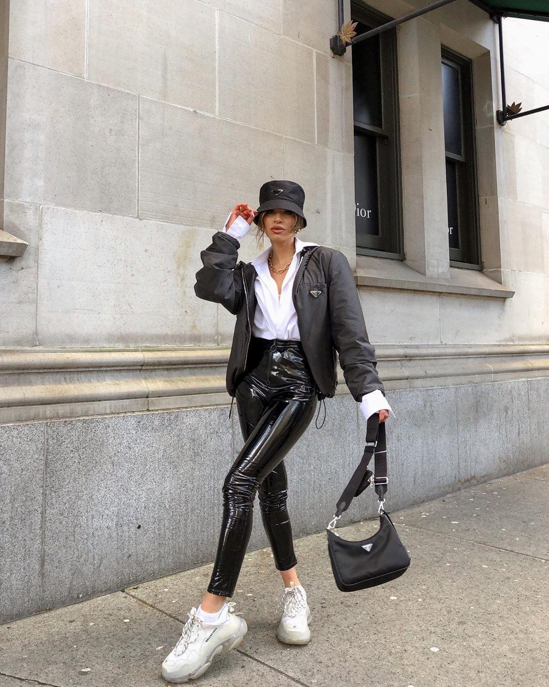 pants black vinyl pants sneakers white shirt black bag bag black jacket hat