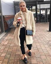 coat,faux fur coat,beige coat,h&m,black loafers,mules,black high waisted pants,gucci belt,knitted sweater,black bag