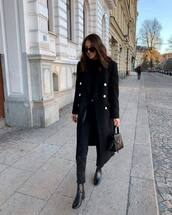 coat,long coat,black boots,black jeans,handbag,black turtleneck top