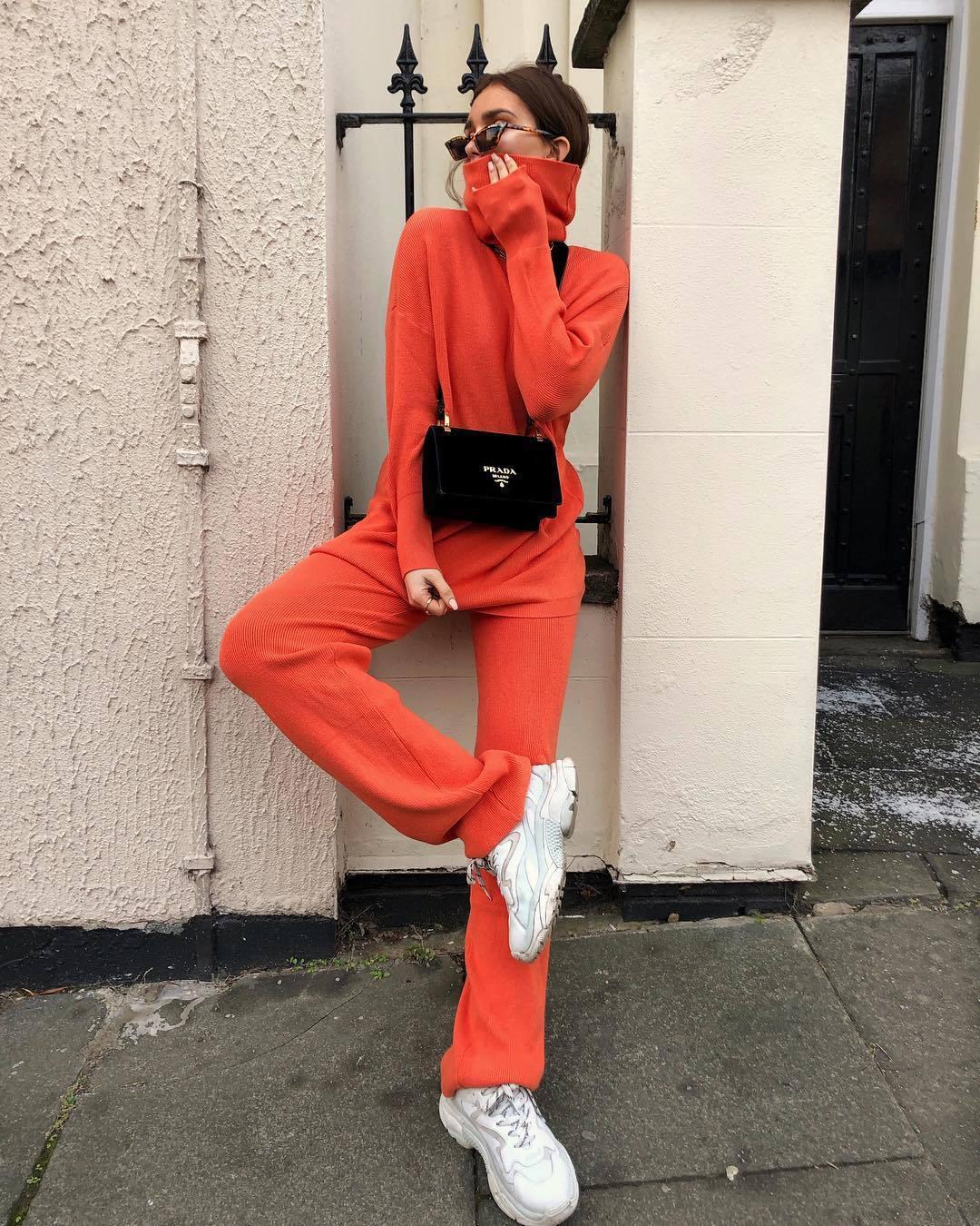 sweater turtleneck sweater neon wide-leg pants white sneakers black bag prada bag sunglasses