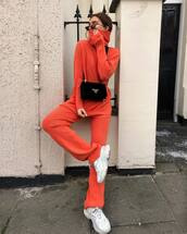 sweater,turtleneck sweater,neon,wide-leg pants,white sneakers,black bag,prada bag,sunglasses