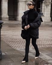 shoes,black boots,ankle boots,black pants,slit pants,black jacket,puffer jacket,black turtleneck top,black bag,furry bag