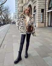 jacket,faux fur jacket,black boots,ankle boots,black leather pants,turtleneck sweater,white sweater,round bag
