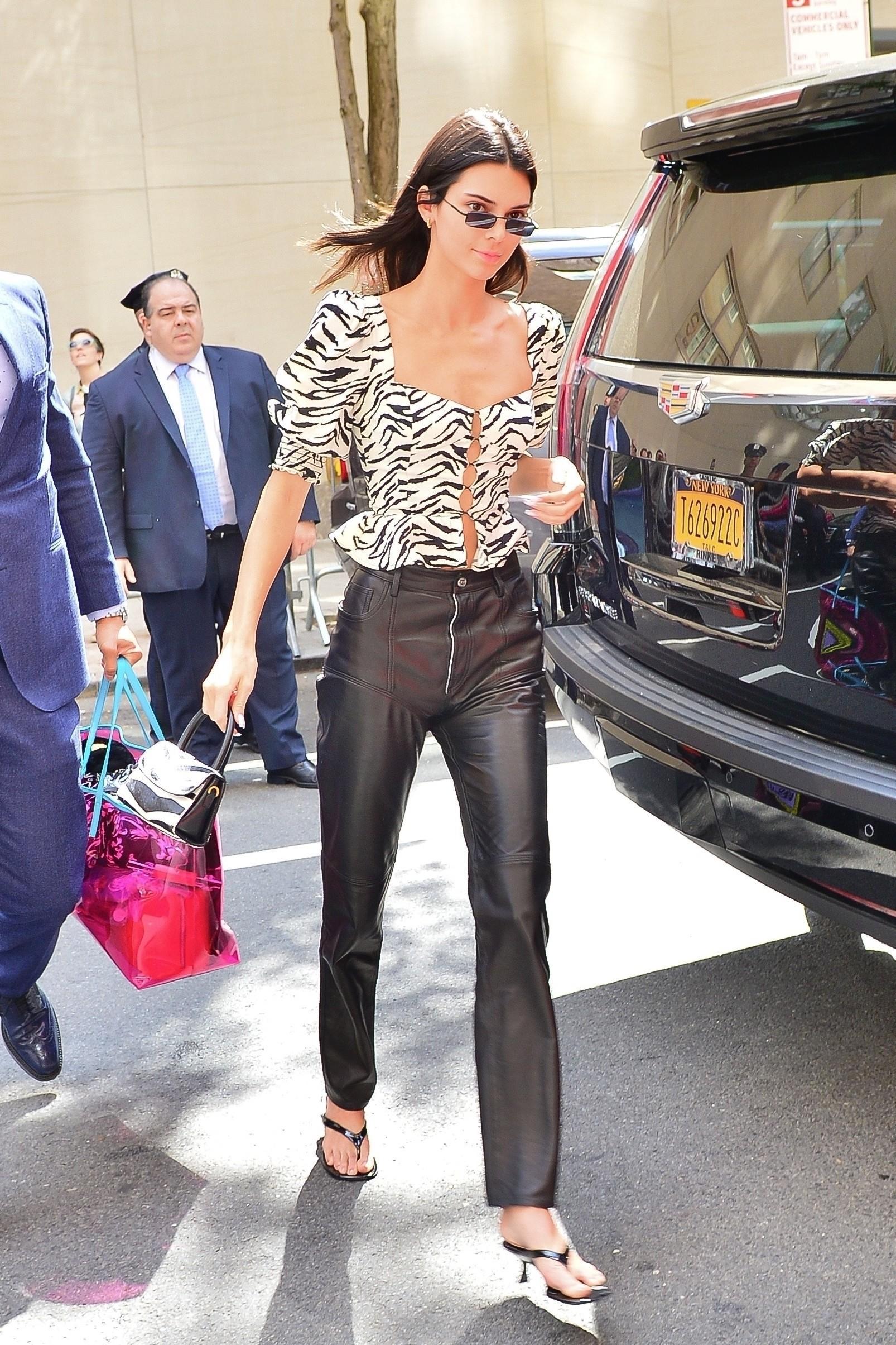 top black and white celebrity kendall jenner spring outfits pants sandals kardashians model off-duty animal print zebra print zebra