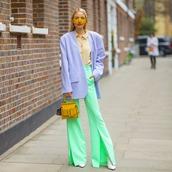 pants,high waisted pants,flare pants,slit pants,yellow bag,handbag,white boots,blazer,shirt,sunglasses