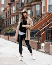 pants,leather leggings,black leggings,white sneakers,camel coat,white t-shirt,black sweater,crossbody bag