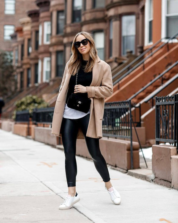 pants leather leggings black leggings white sneakers camel coat white t-shirt black sweater crossbody bag