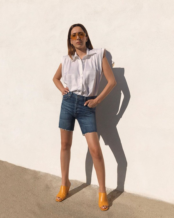 top white shirt sleeveless denim shorts sandals