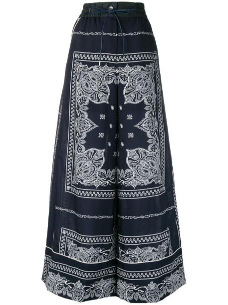 Sacai mandala print trousers in blue