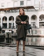 coat,long coat,brown boots,heel boots,black bag,turtleneck sweater,black sweater,tights