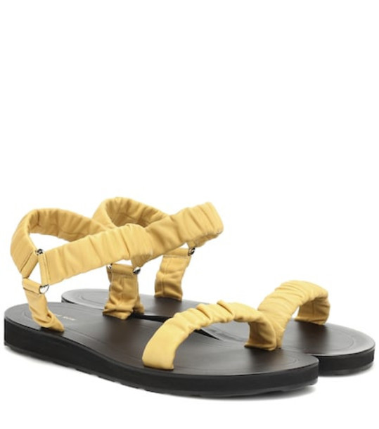 The Row Egon leather sandals in yellow