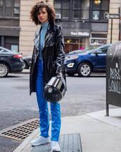 pants,blue pants,high waisted pants,white sneakers,vinyl,black coat,blue sweater,turtleneck sweater