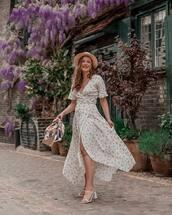 dress,wrap dress,asymmetrical dress,floral dress,short sleeve dress,white sandals,handbag,hat