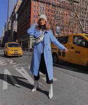 coat,long coat,blue coat,white boots,heel boots,ankle boots,straight pants,capri pants,belt bag,turtleneck sweater,beanie