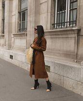 coat,brown coat,long coat,black boots,woven bag