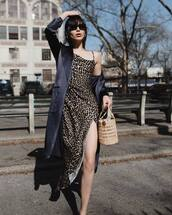 dress,slit dress,leopard print,asymmetrical dress,satin,blazer,bucket bag,handbag,wood,black sunglasses