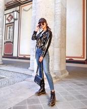 jacket,black jacket,biker jacket,vinyl,black boots,platform boots,DrMartens,black bag,skinny jeans,high waisted jeans,white t-shirt,cap