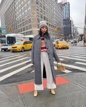 coat,long coat,boots,wide-leg pants,white pants,striped sweater,beanie,bag