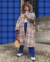 coat,long coat,plaid,oversized coat,white sneakers,shoulder bag,high waisted pants,blue pants,sweater,striped sweater