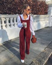 jumpsuit,red jumpsuits,white sneakers,handbag,brown bag,white shirt
