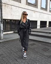 shoes,sneakers,versace,joggers,black leather jacket,black top,sunglasses