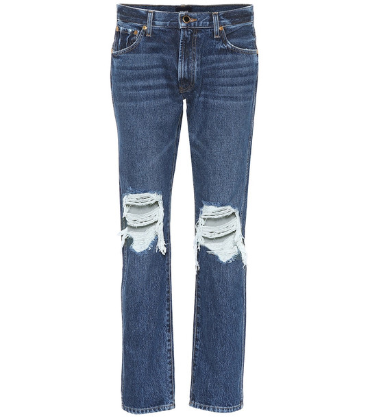 Khaite The Kyle low-rise distressed jeans in blue