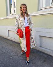 coat,long coat,floral,prada,red bag,high waisted pants,white shirt,pumps