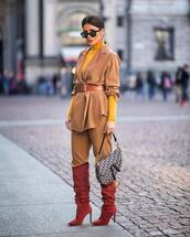 jacket,blazer,beige pants,pleated,knee high boots,heel boots,red boots,dior bag,turtleneck,belt