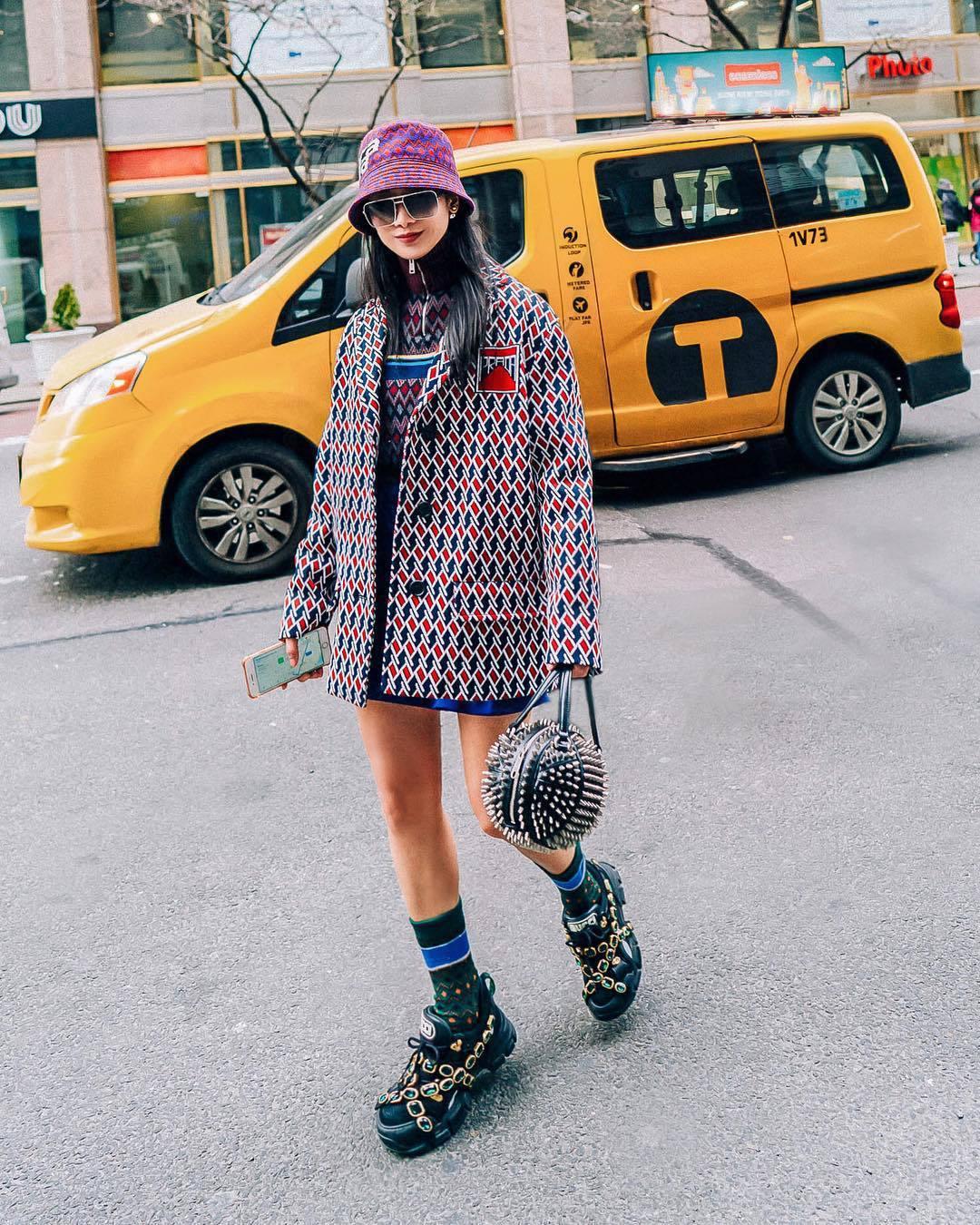 bag gucci bag black bag basket bag black shoes socks coat prada turtleneck sweater mini skirt printed bucket hat