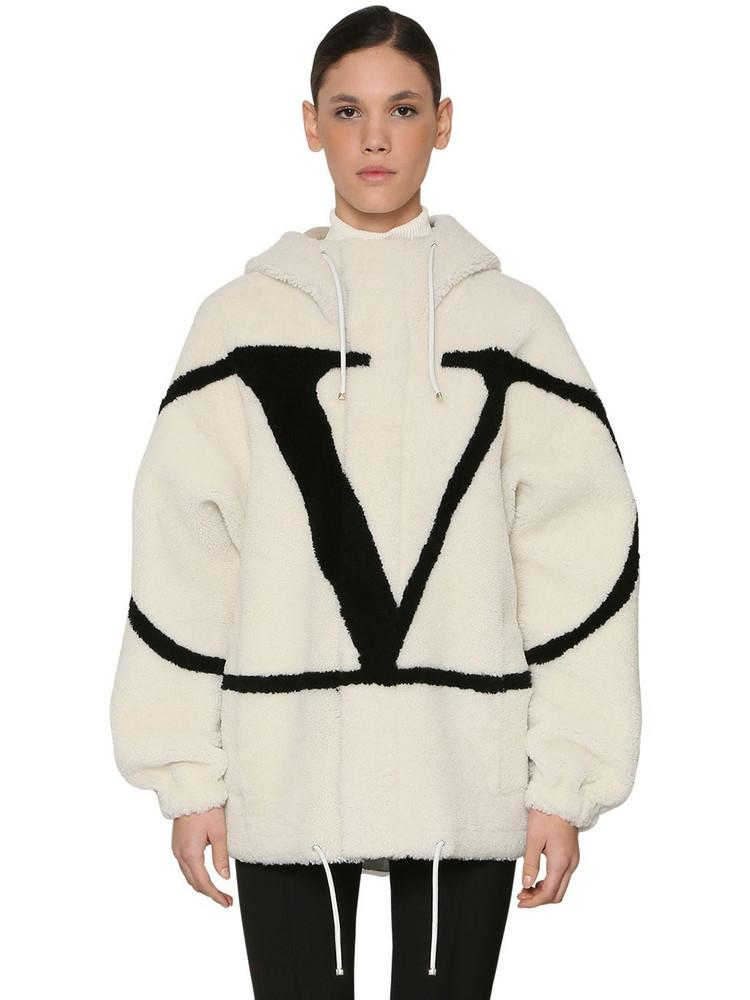 VALENTINO Vlogo Intarsia Hooded Shearling Jacket in black / white