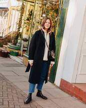 coat,black coat,long coat,patent boots,cropped jeans,straight jeans,sweatshirt,crossbody bag,black bag