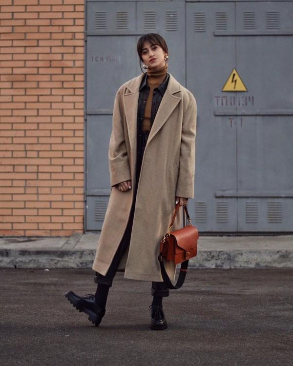 coat long coat brown bag black shoes black leather pants tights black shirt leather turtleneck