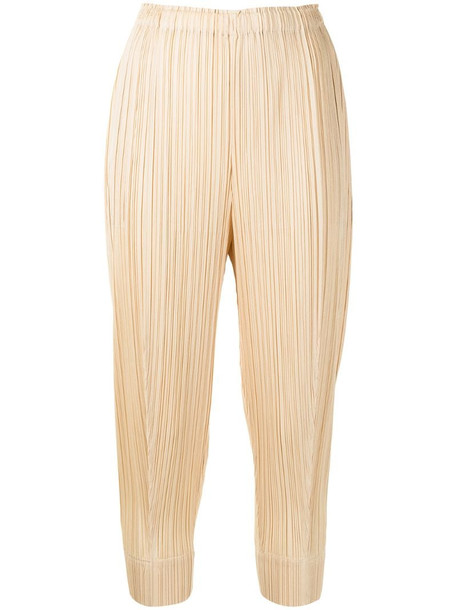 Pleats Please Issey Miyake cropped pleated trousers in yellow
