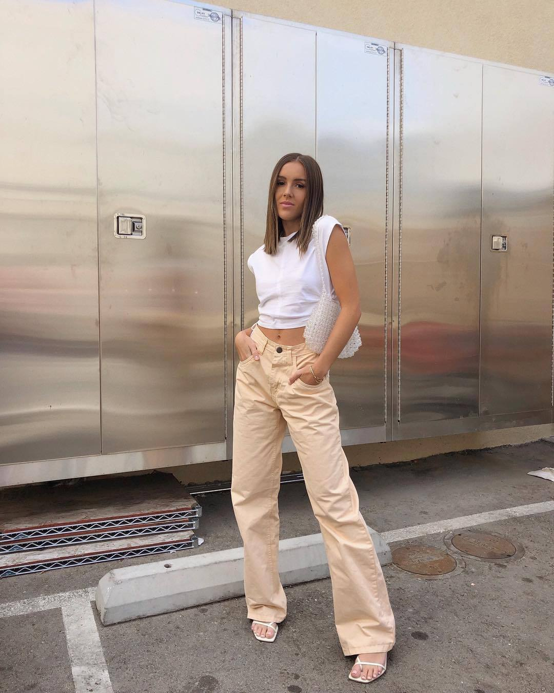 top white t-shirt cropped wide-leg pants high waisted pants white sandals shoulder bag