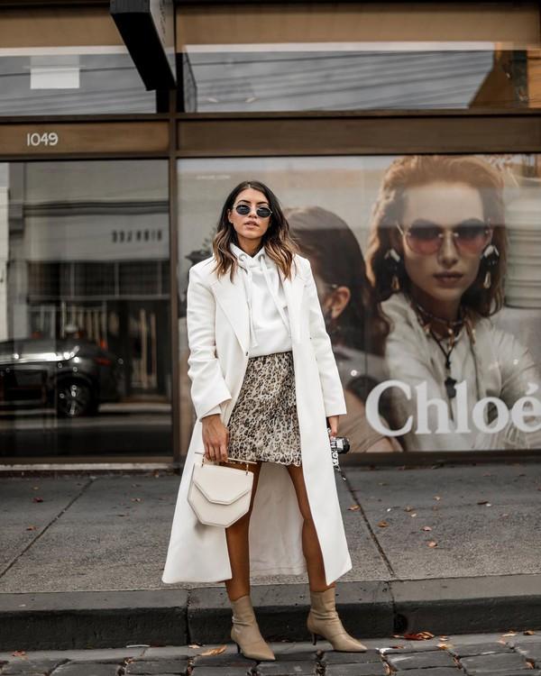 coat white coat long coat ankle boots mini skirt white sweater handbag