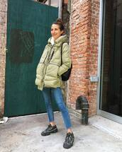 jacket,puffer jacket,olive green,black sneakers,skinny jeans,black bag,sportswear