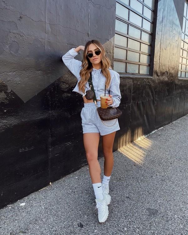 sweater hoodie short white sneakers crossbody bag