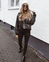 jeans,black skinny jeans,black boots,ankle boots,ysl bag,black bag,black leather jacket,black hoodie,beanie
