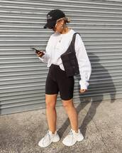 shorts,black shorts,sweatshirt,white sneakers,black bag,belt bag,cap
