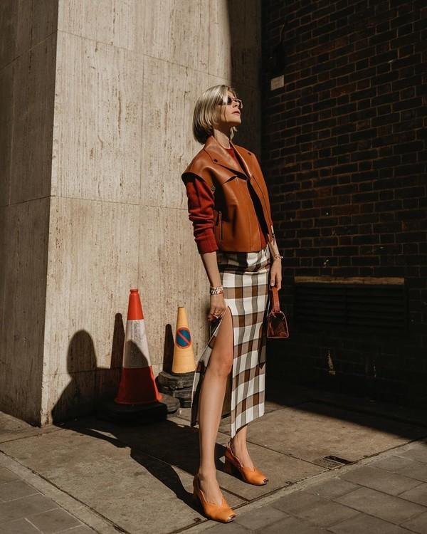 skirt plaid skirt slit skirt pumps handbag vest leather sweater