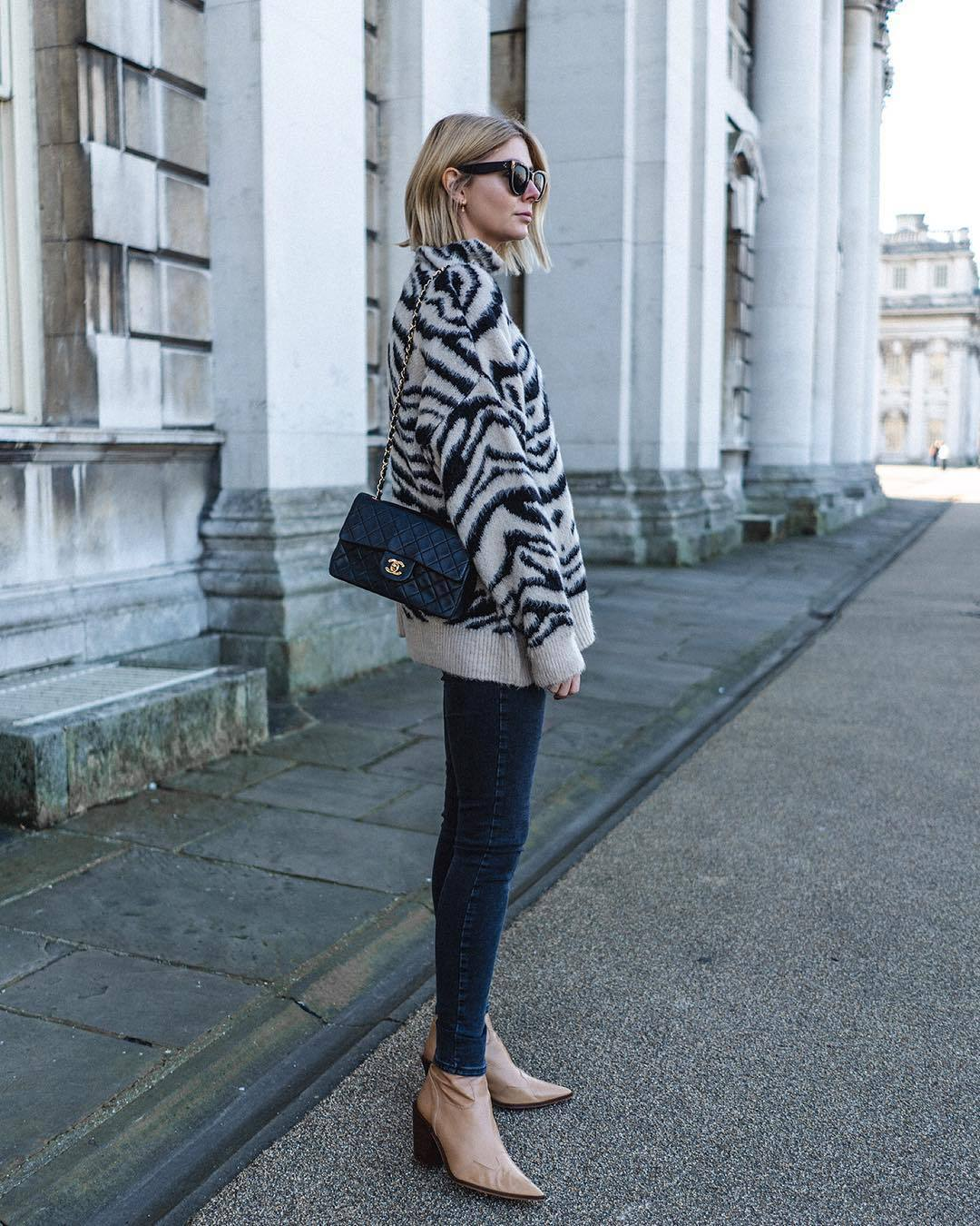 sweater oversized sweater zebra print ankle boots heel boots skinny jeans chanel bag black bag