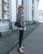 sweater,oversized sweater,zebra print,ankle boots,heel boots,skinny jeans,chanel bag,black bag
