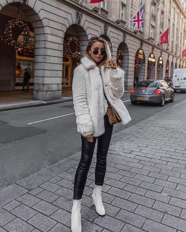 coat faux fur coat white coat white boots ankle boots black leather pants crossbody bag