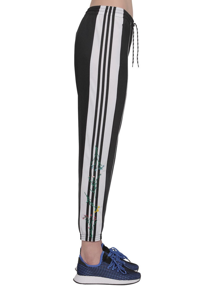 ADIDAS ORIGINALS Flower Jersey Track Pants in black