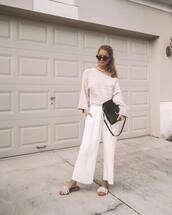 pants,wide-leg pants,white pants,slide shoes,knitted sweater,black bag,crossbody bag