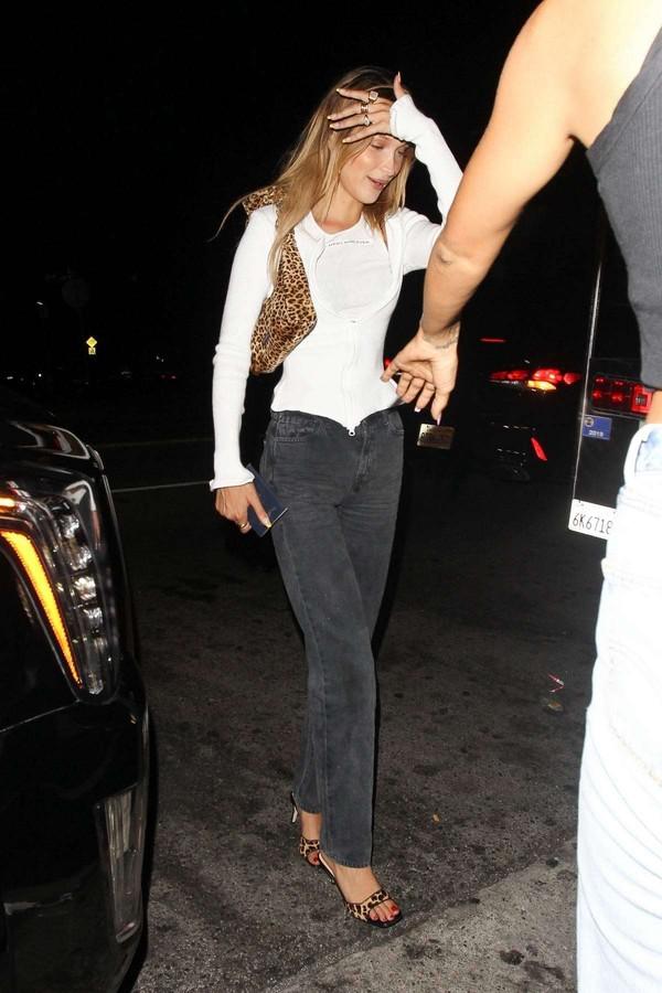 jeans black jeans bella hadid model off-duty top white top celebrity