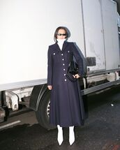 coat,wool coat,long coat,navy coat,white boots,heel boots,black bag,white turtleneck top