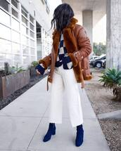 jacket,shearling jacket,brown jacket,aviator jacket,blue boots,ankle boots,suede boots,wide-leg pants,white pants,cropped pants,high waisted pants,knitted sweater,madewell